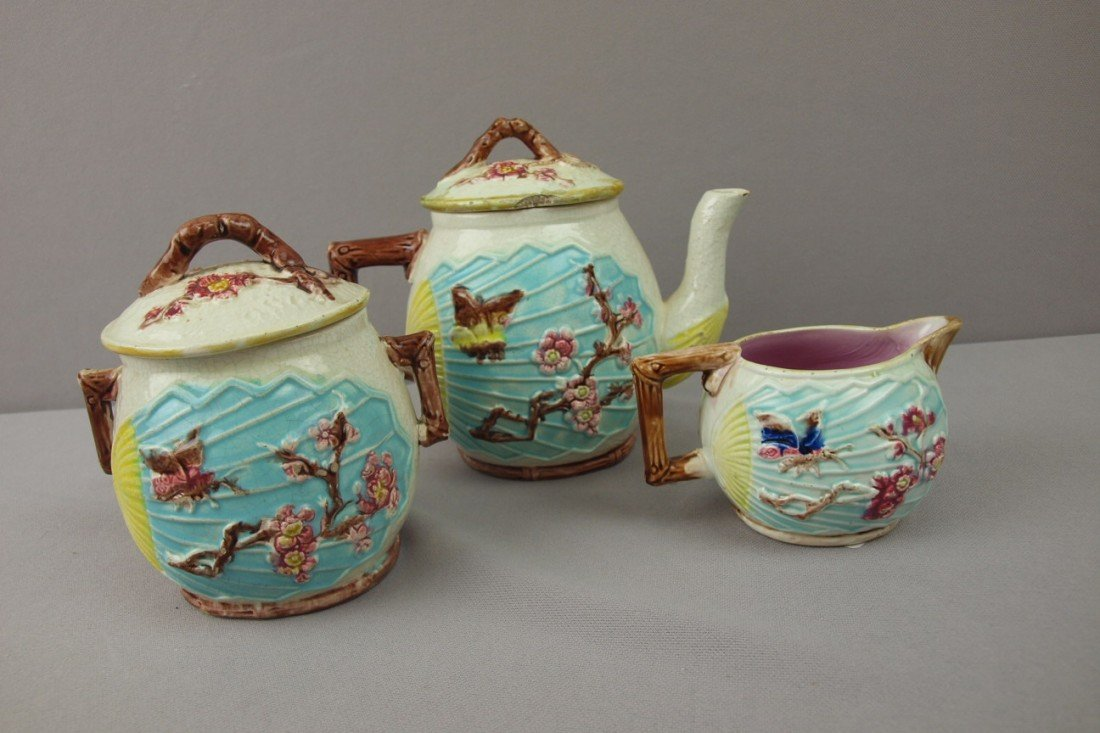 22:  Majolica bird and fan 3 piece teaset, various cond