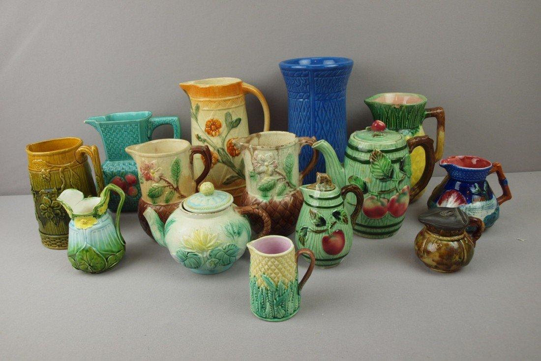 28:  Majolica lot of 14 items - pitchers, creamers, tea