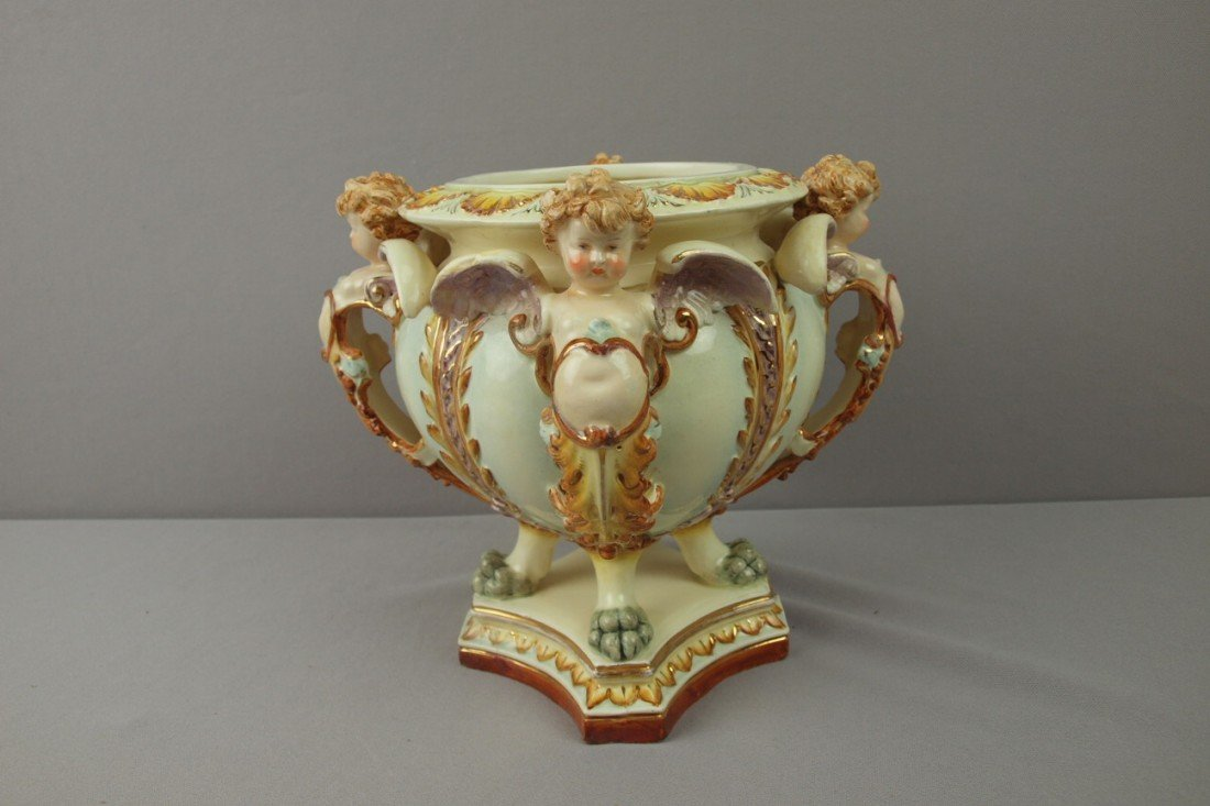 29:  HUGO LONITZ jardiniere with 4 winged angels and pa