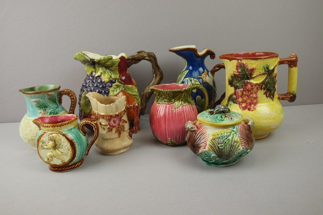 32:  Majolica lot of 7 pitchers and 1 sugar, 2 pitchers