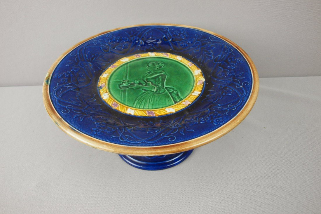 35:  JRL majolica scenic comport with lady carrying tea