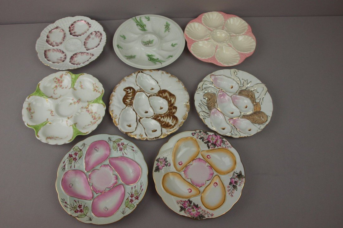 41:  Porcelain lot of 8 oyster plates and one shooter,