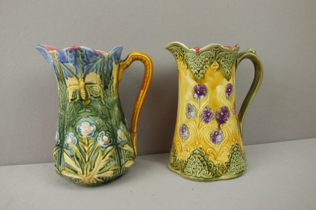 47:  Onnaing lot of 2 floral pitcher, one with butterfl
