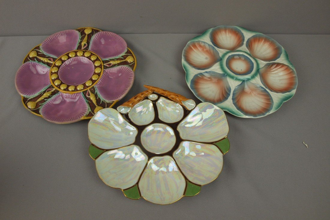 48:  Lot of 2 majolica and one porcelain oyster plates,