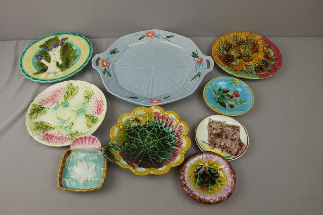 50:  Majolica lot of 9 plates and trays, various condit