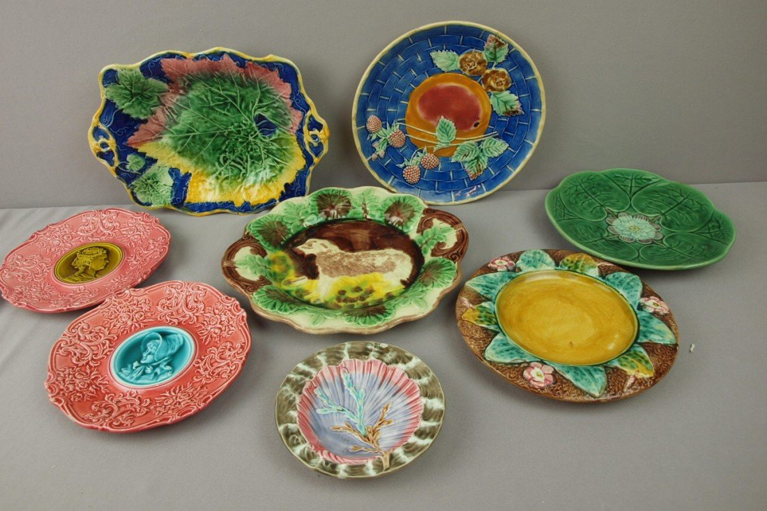 57:  Majolica lot of 8 plates and platters, various con