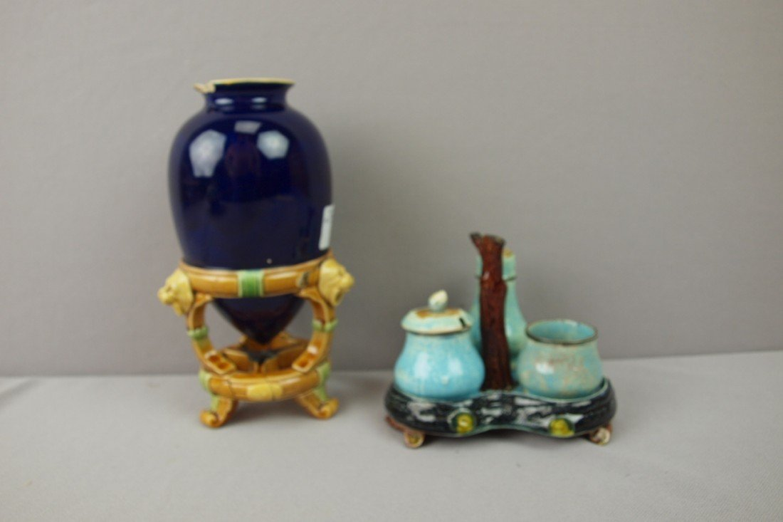 59:  MINTON cobalt ovoid vase with lion stand, base bro