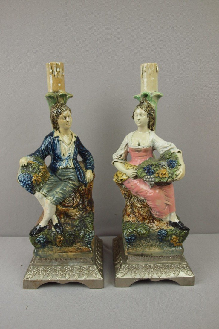 90:  Pair of majolica candle holders of man and woman o