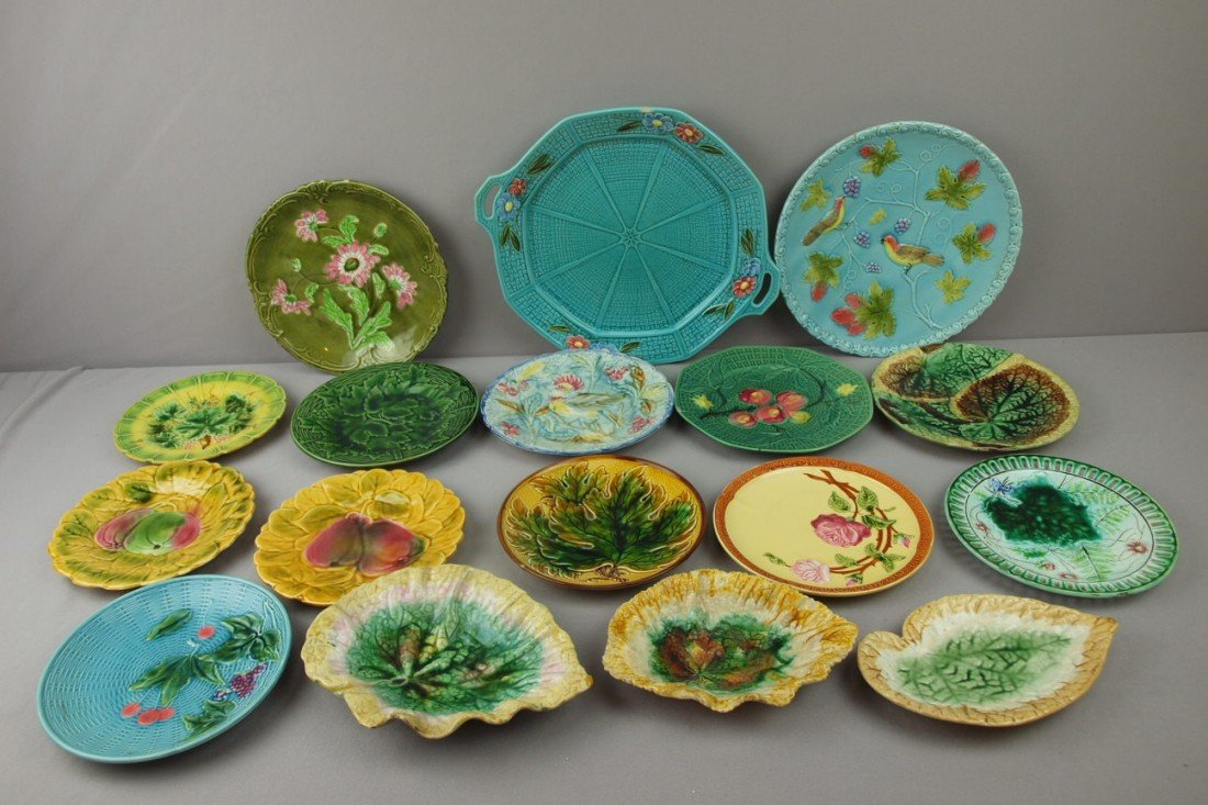 91:  Majolica lot of 17 plates, trays and begonia dishe