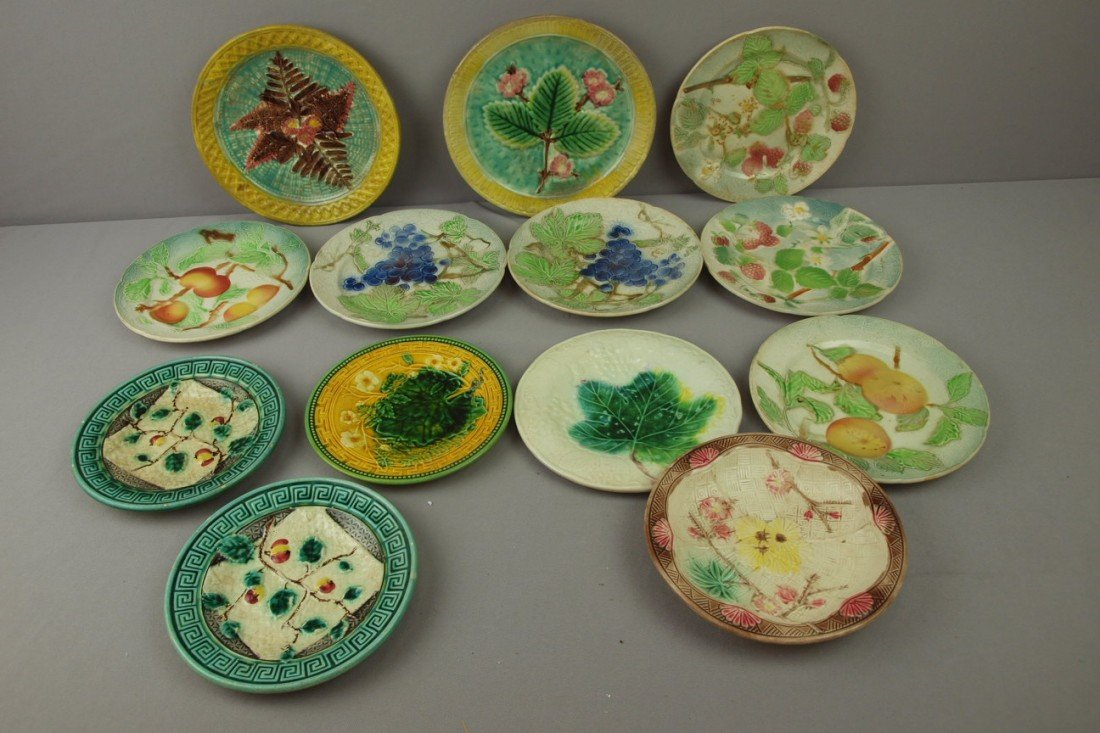 111:  Majolica lot of 13 plates, various condition