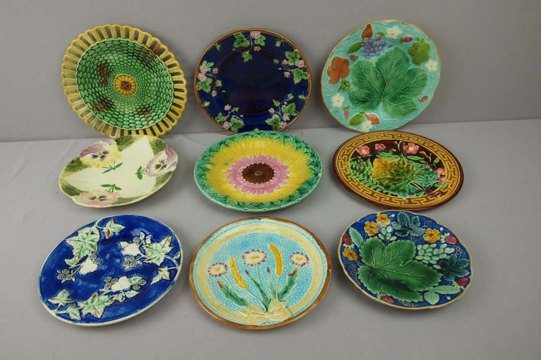113:  Majolica lot of 9 plates, various condition