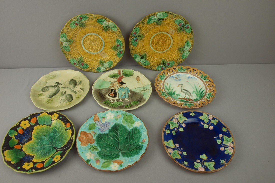 114:  Majolica lot of 8 plates, various condition