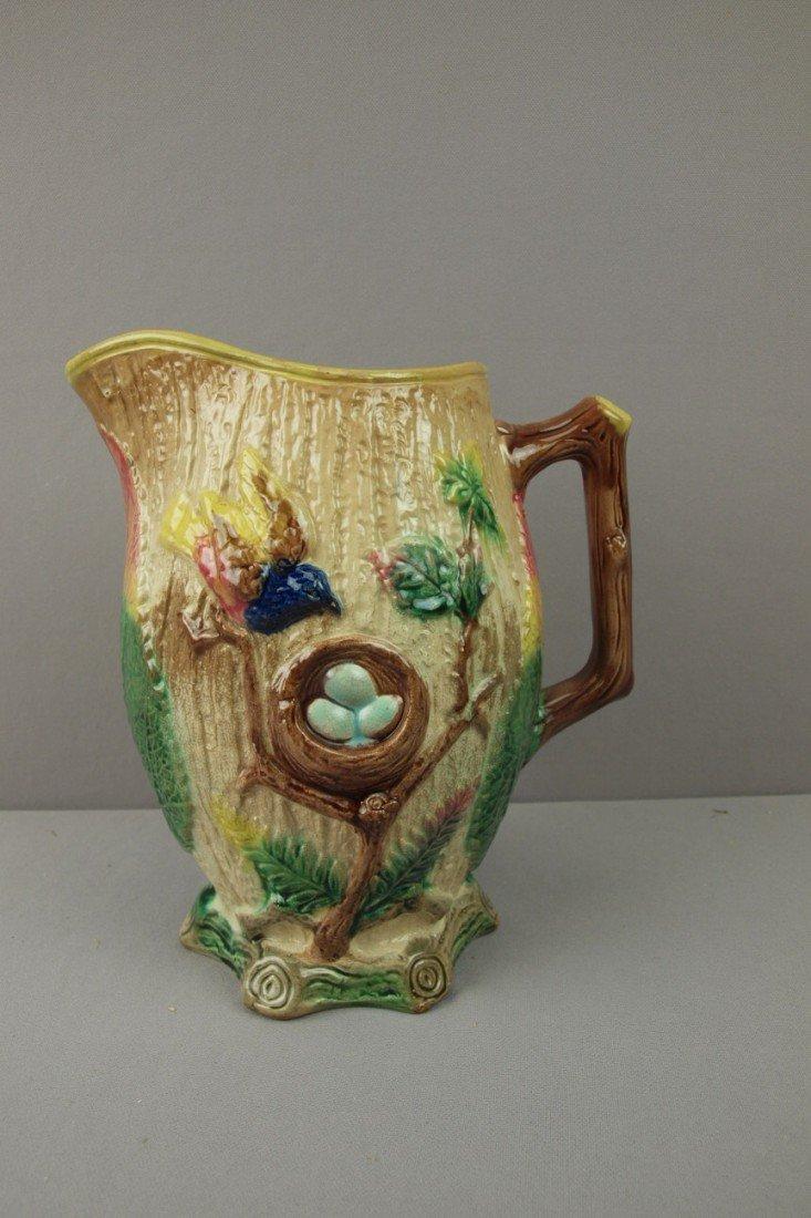 125:  Bird and bird's nest pitcher with begonia leaf sp