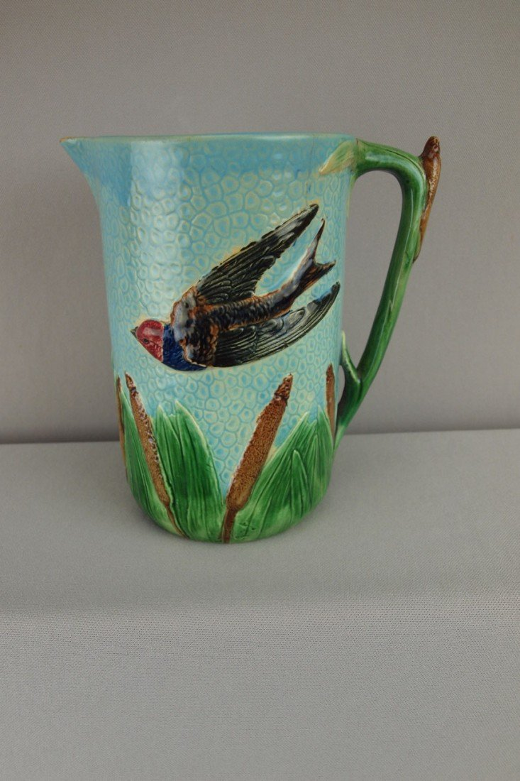 144:  HOLDCROFT bird in flight and cattail pitcher, min