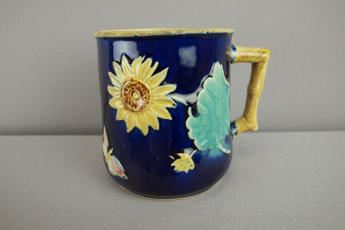 145:  Majolica cobalt sunflower and butterfly mug with