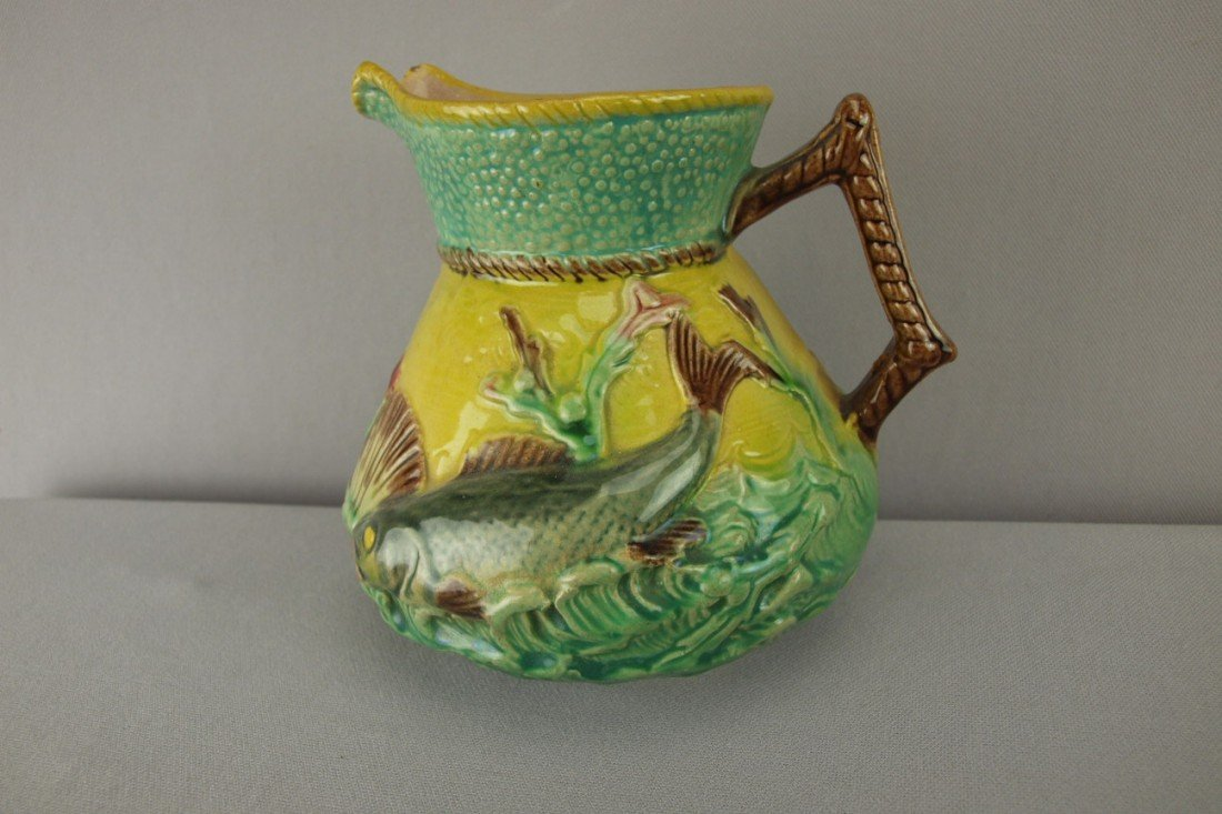 155:  Fish on waves pitcher with yellow ground, 6""