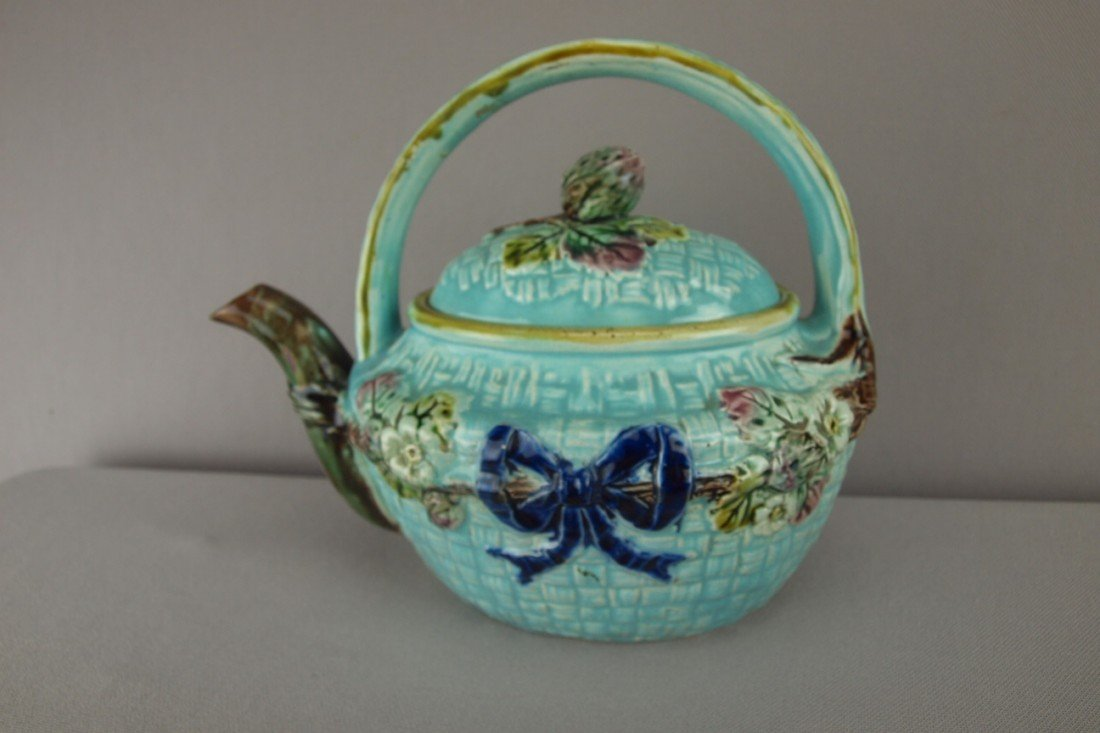 157:  Turquoise majolcia teapot with floral motif and c