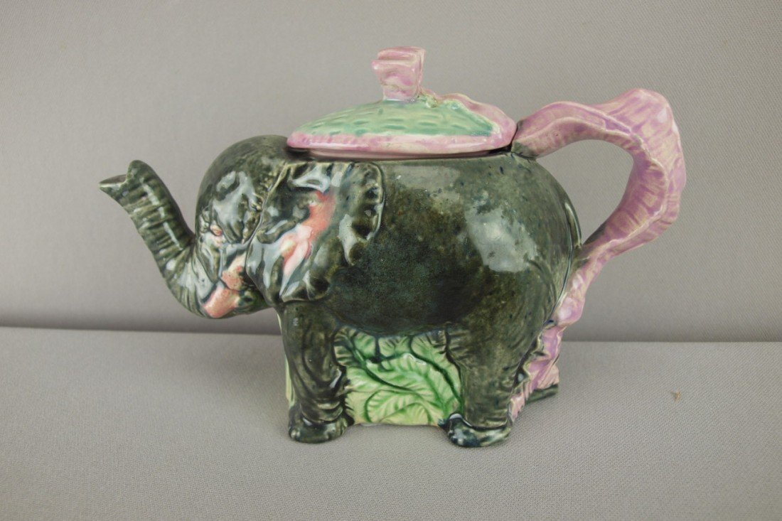 160:  Majolica figural elephant teapot with pink ribbon