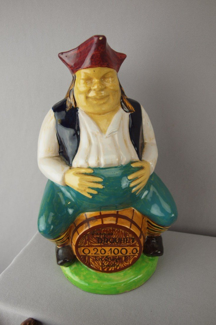 210:  French Tessier figural jug of man on barrel with