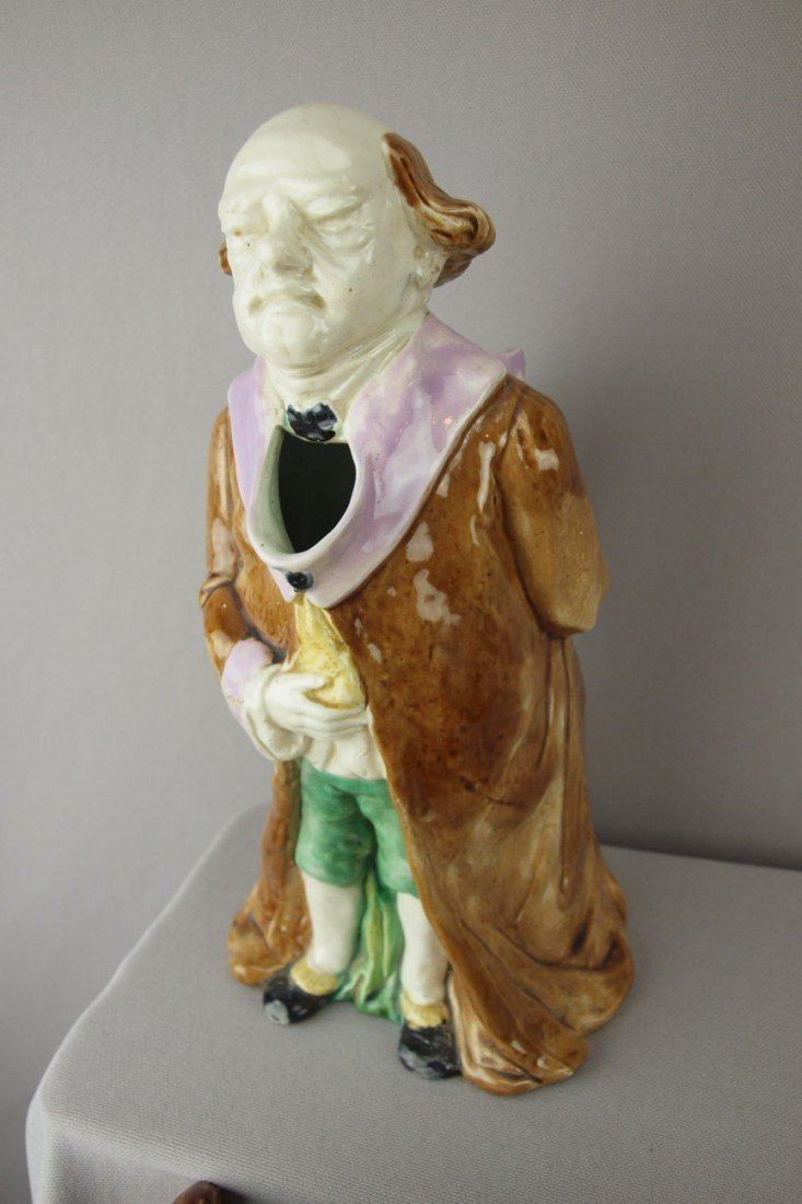 """211:  Majolica figural pitcher of a """"Judge"""" with robe,"""
