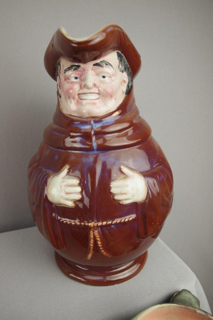 "212:  Monk figural jug, 10"""