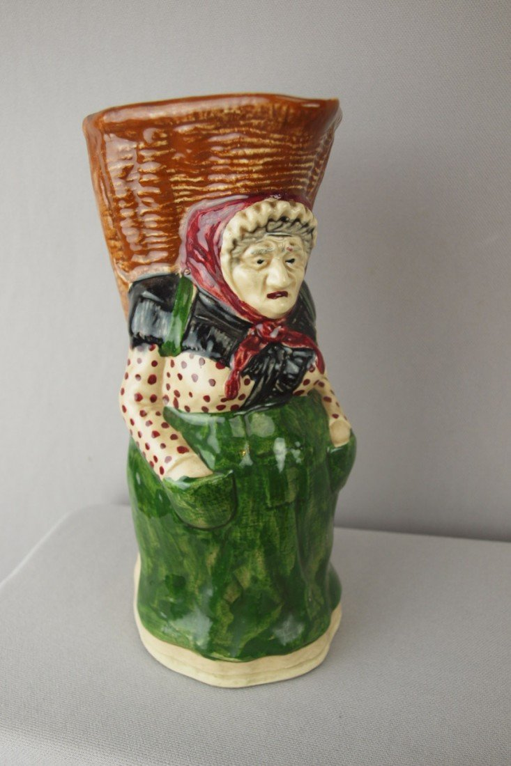 214:  French Orchies figural pitcher of lady with baske
