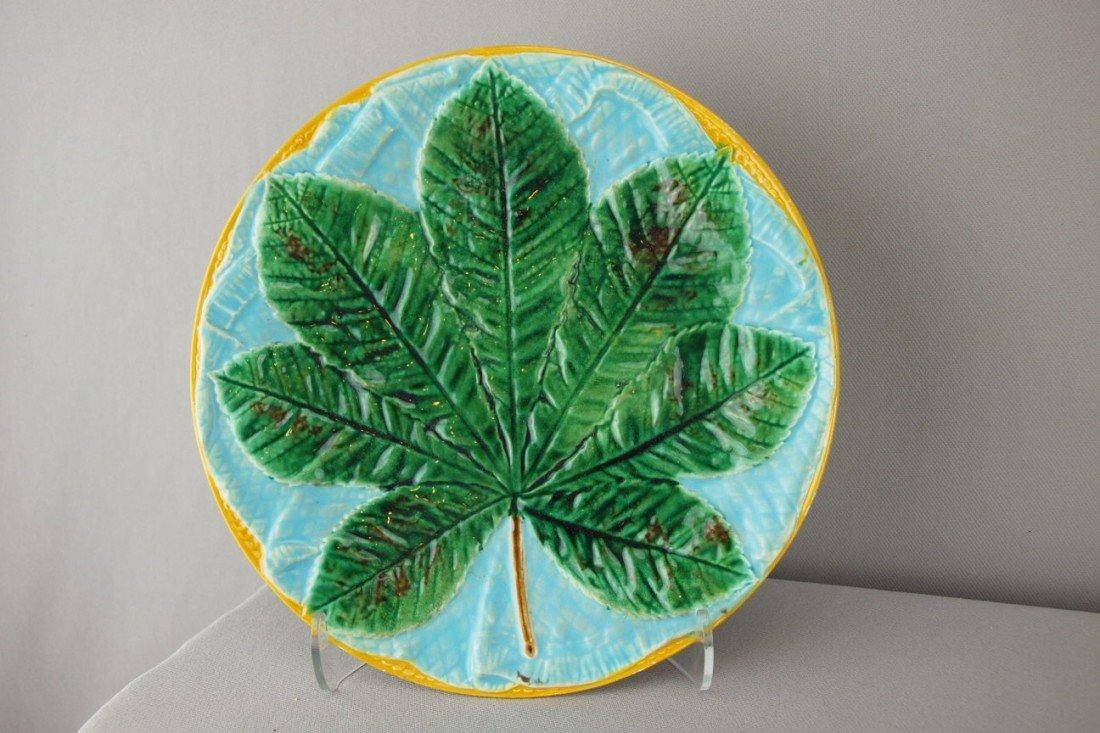 505:  GEORGE JONES chestnut leaf on turquoise napkin pl