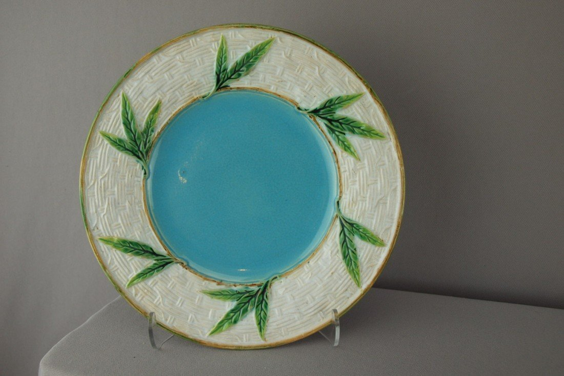 507:  GEORGE JONES wicker and bamboo plate with turquoi