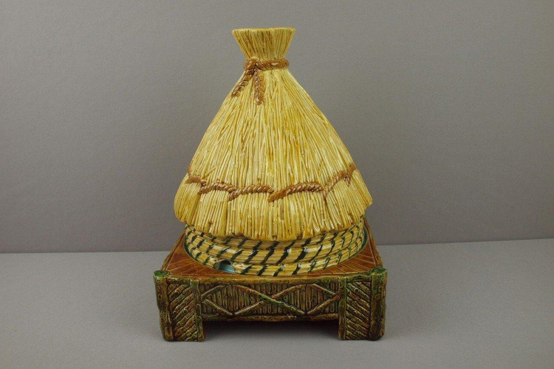 582:  GEORGE JONES majolica thatched hut cheese keeper