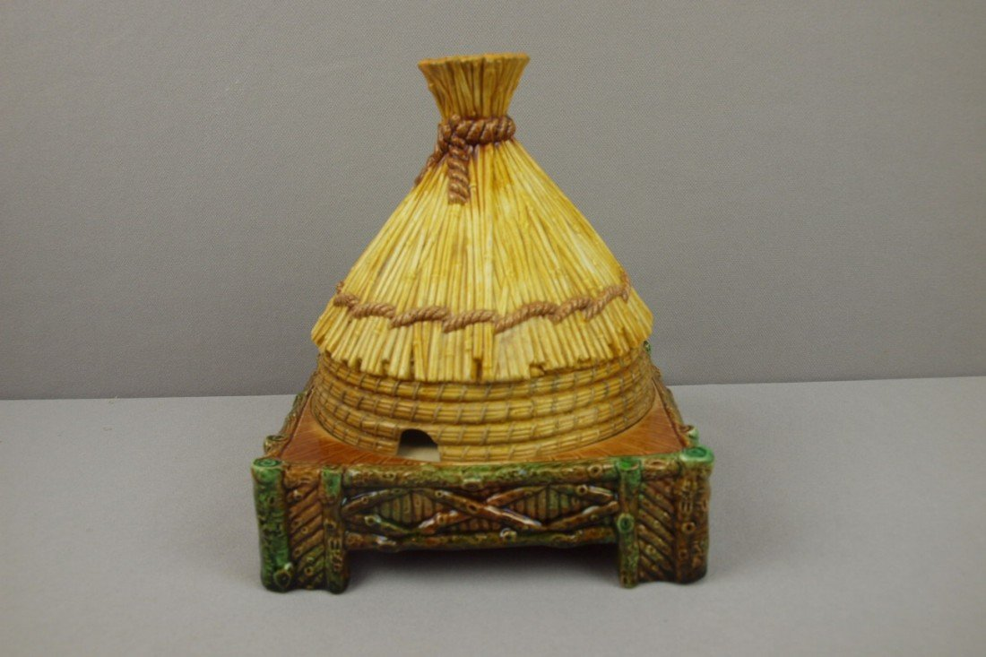 583:  GEORGE JONES majolica small thatched hut cheese k