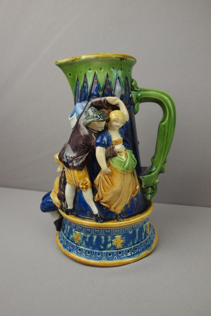 594:  MINTON tavern jug with figures in high relief, re