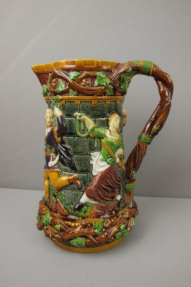 595:  MINTON majolica tower jug with figures in relief,