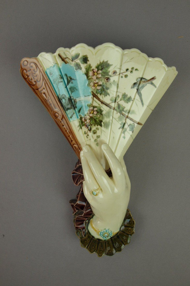 645:  French majolica hand and fan wall pocket with bir