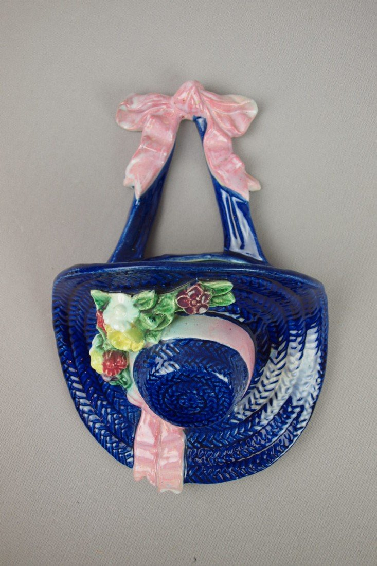 648:  Majolica cobalt bonnet with flowers and pink ribb