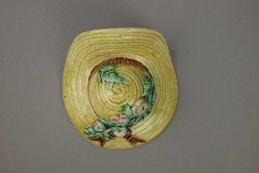 649:  Majolica yellow bonnet with flowers wall pocket,