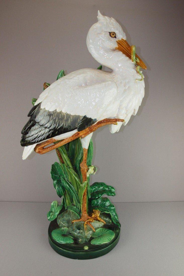 661:  MINTON majolica stork walking stick stand with bu