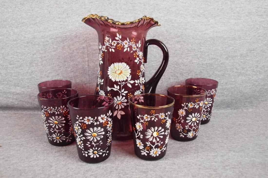 46: Amethyst 7 piece water set with enamel floral motif