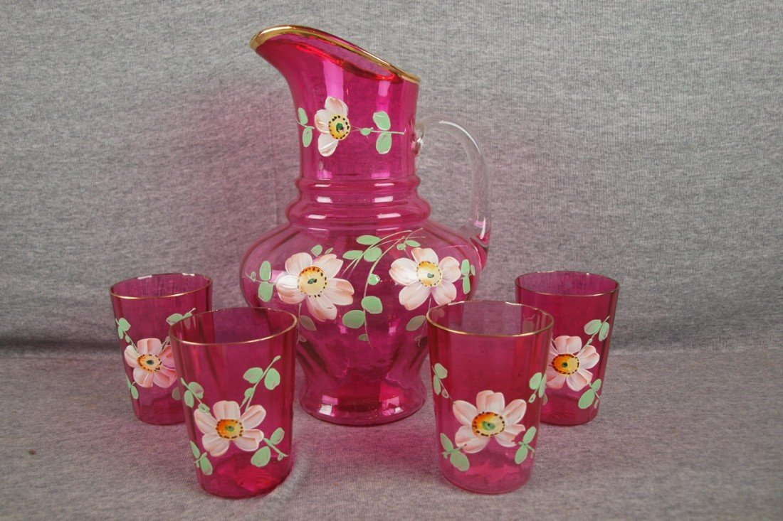 48: Cranberry glass 5 piece water set with floral ename