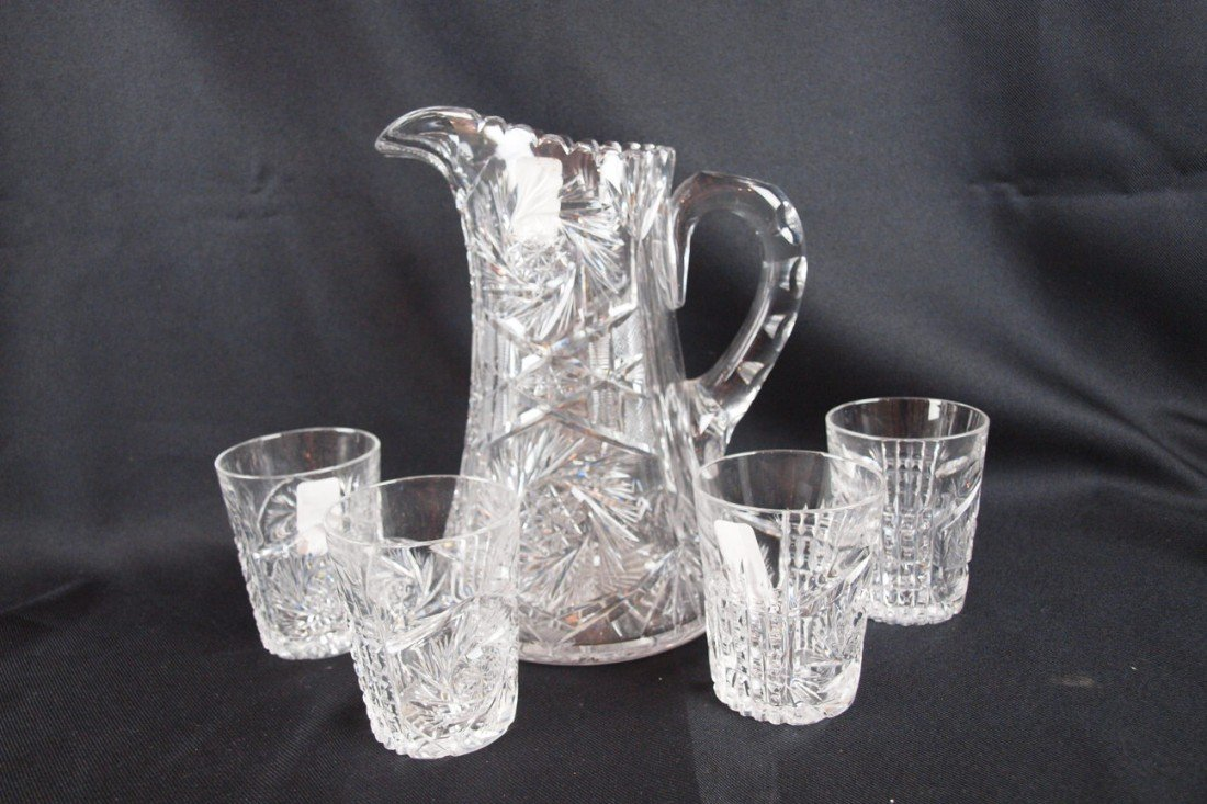 192: Cut glass pitcher and 4 tumblers, rim nick to one