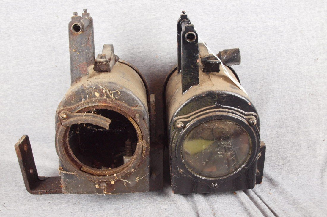65: Pair of Western cast iron railroad lights, one with