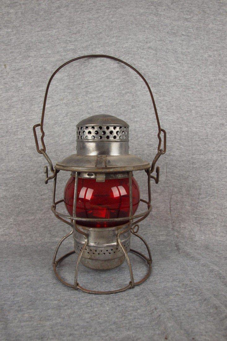72: Adlake railroad lantern with short red globe both e