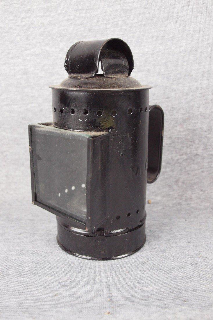 "127: Small hand held lantern embossed ""MCF"""