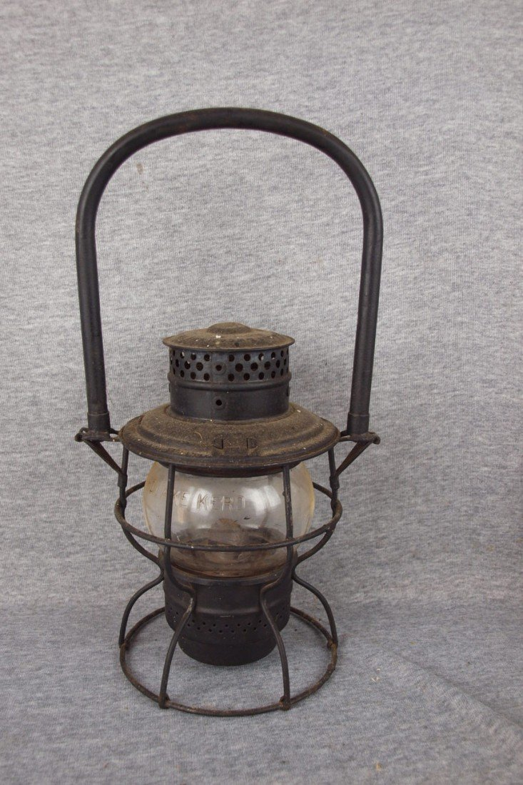 "135: Adams & Westlake railroad lantern embossed ""MCRR"""