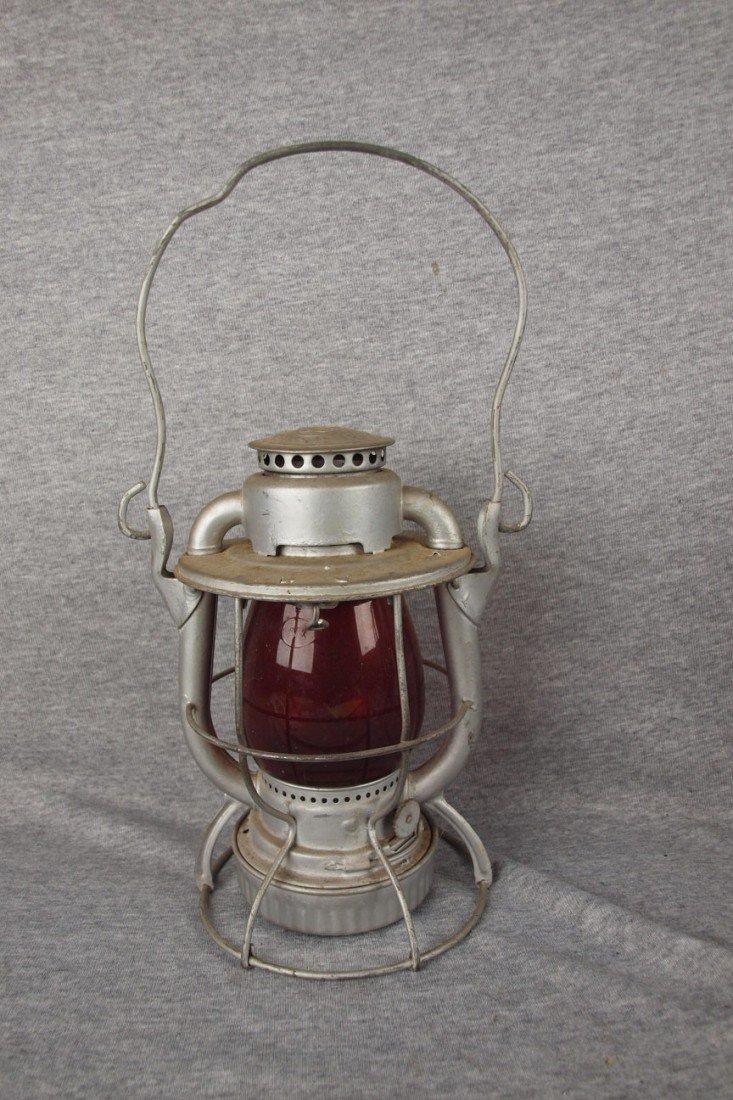 144: Dietz Vesta railroad lantern with red globe both e