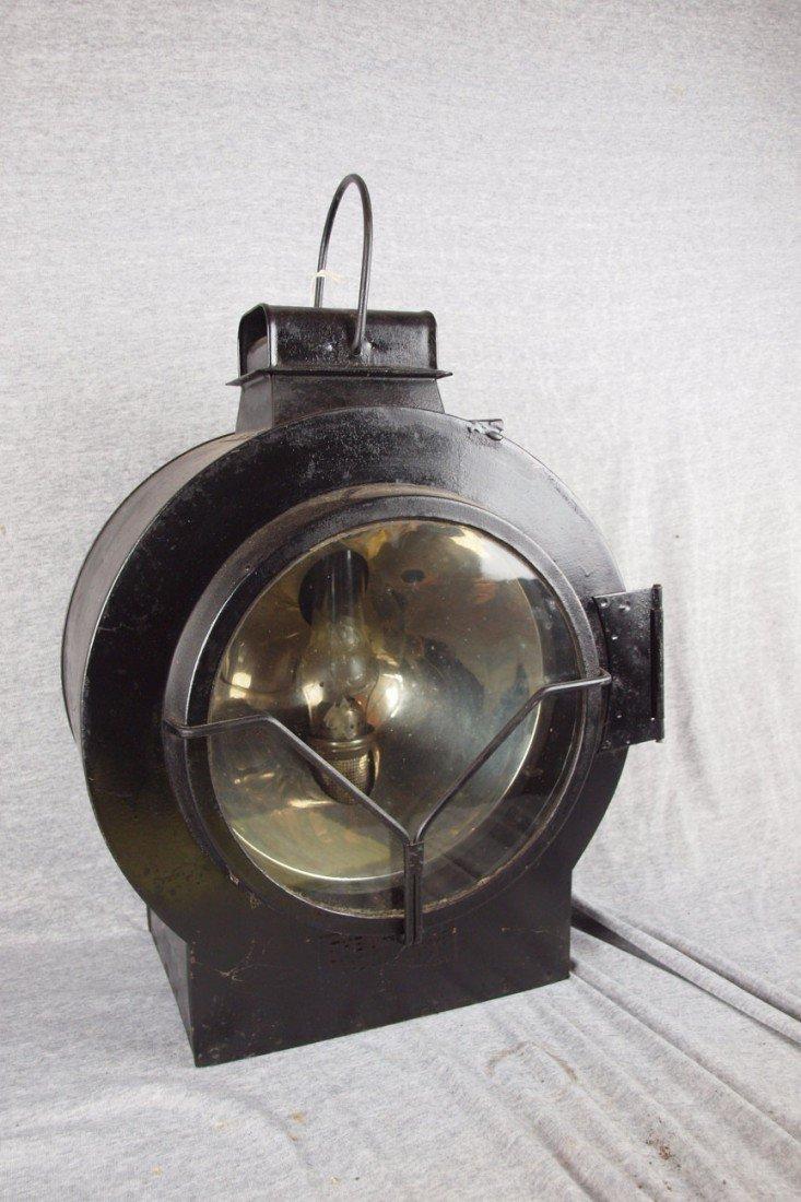 162: Early railroad engine headlight, (broken chimney),