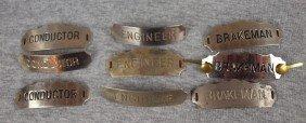 "10:  Lot of 9 railroad hat badges - 3 ""Conductor"", 3 ""E"