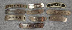 "Lot Of 10 Railroad Hat Badges - ""Trainman"""