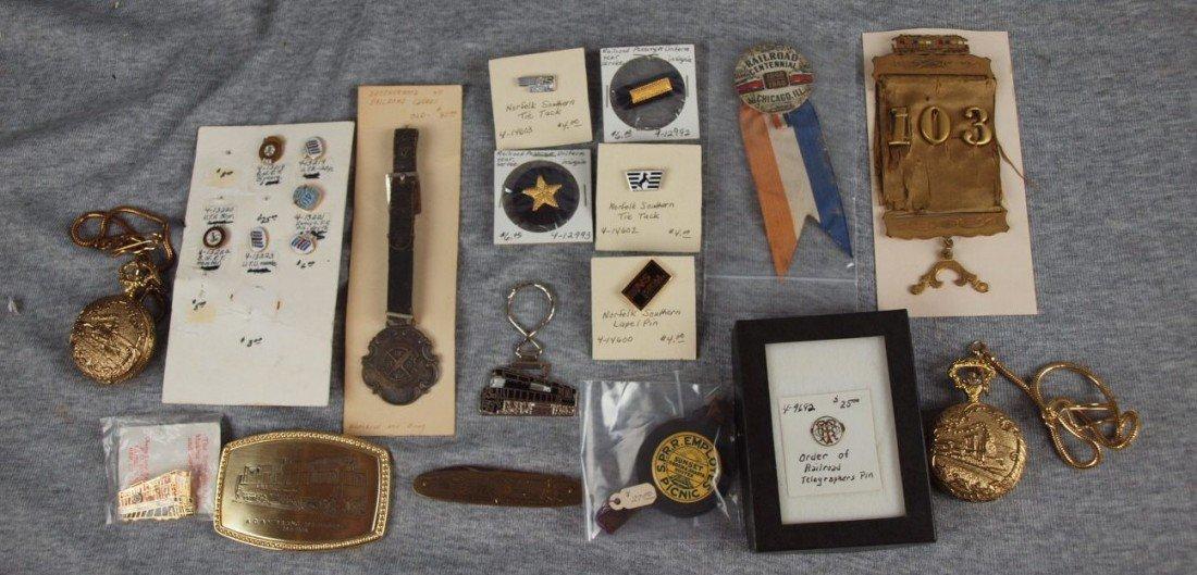 25:  Lot of assorted railroad pins, ribbons, pocket wat