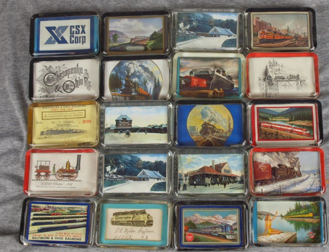 46: Lot of 20 glass paperweights with railroad related