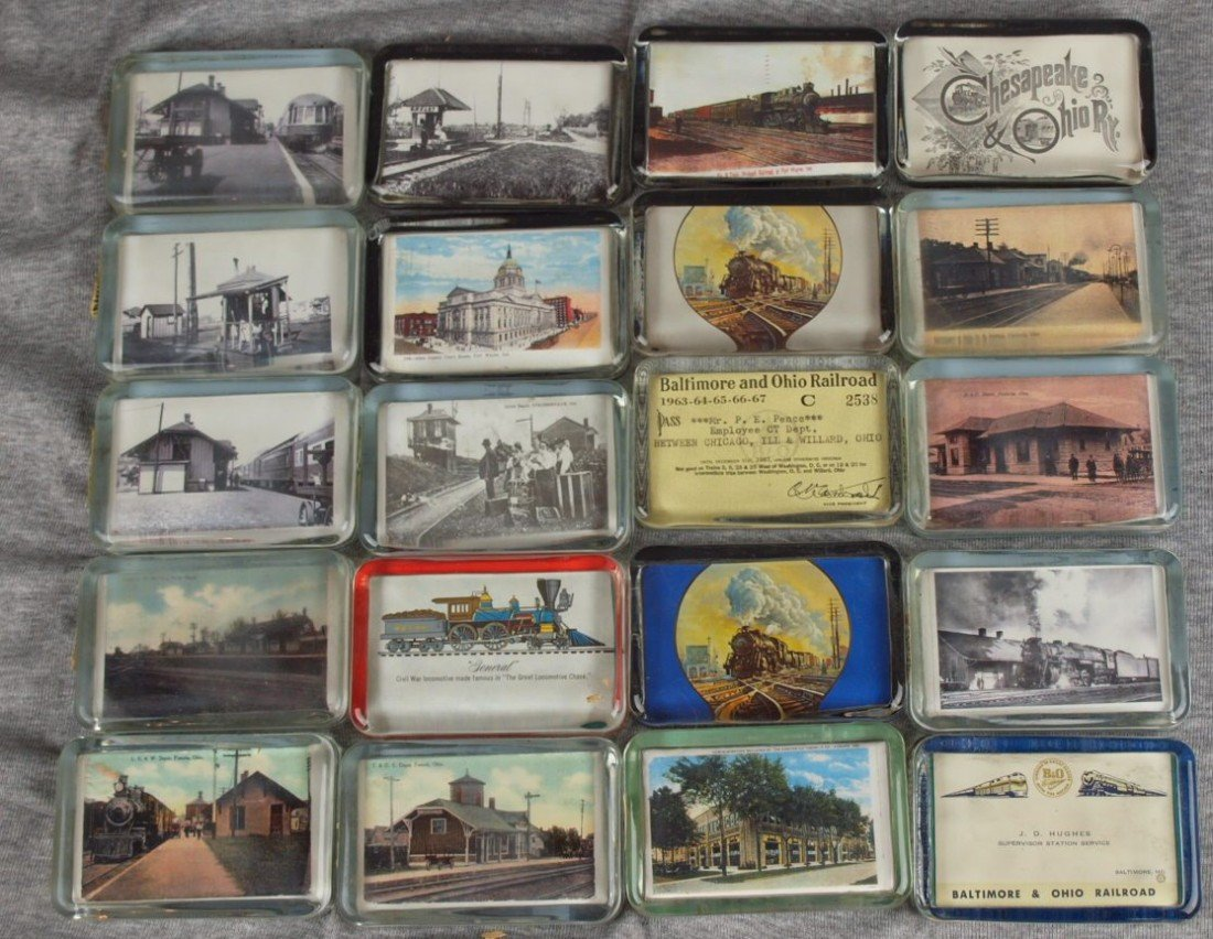 47: Lot of 20 glass paperweights with railroad related